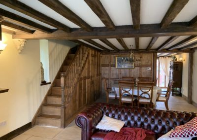 Holiday cottage lounge and stairs to bedrooms